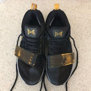 """PG 1s basketball shoes """" black gold colorway""""."""